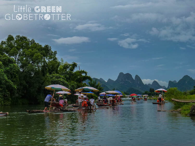 Bamboo rafts sail on the Yulong River in Yangsuo, Guilin, China